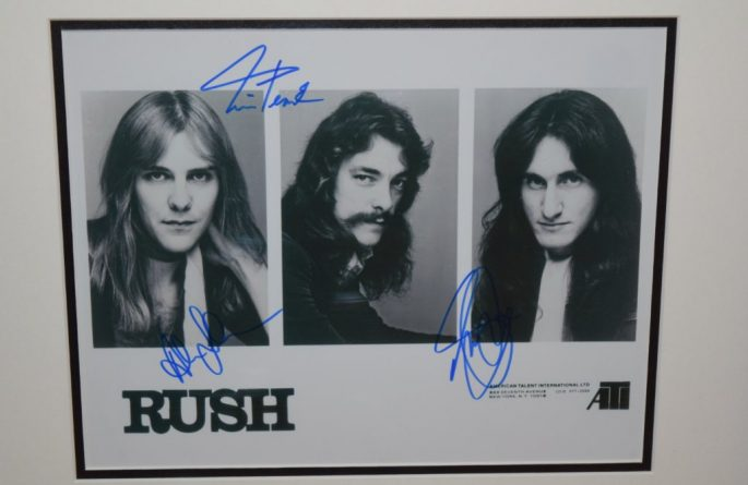 #2-Rush Signed 8×10 B&W Photograph