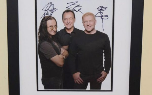 #3-Rush Signed 8×10 Photograph