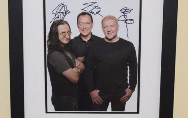 #3-Rush Signed 8×10 B&W Photograph