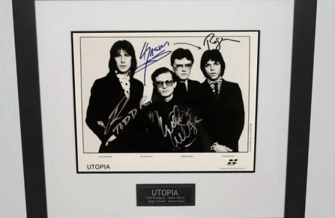 Utopia Signed 8×10 Photograph