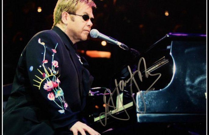 #9 Elton John signed 8×10 Photograph