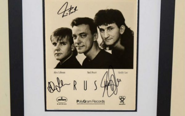 #5-Rush Signed 8×10 Photograph