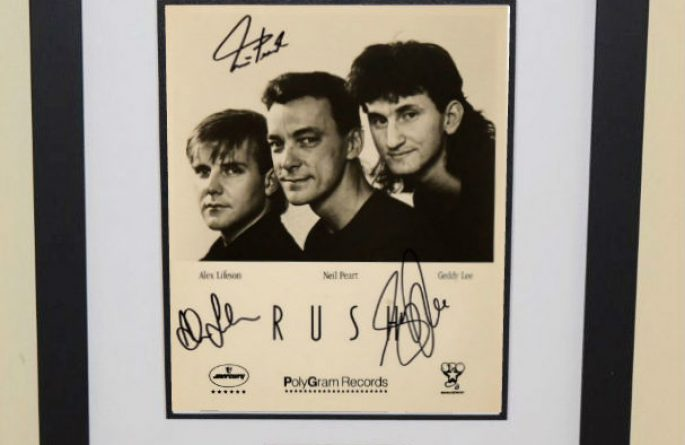 #5-Rush Signed 8×10 Photograph